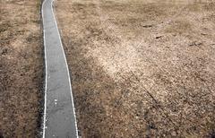 road in depressing landscape - stock photo
