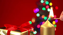 Hand lighting christmas candle with gift and tree Stock Footage