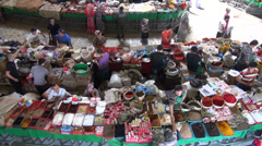 Spices for sale at Central Asian bazaar, overhead view of a market Stock Footage