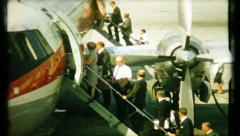 534 - air travelers loading aircraft in the 1950's - vintage film home movie - stock footage