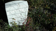 An unknown soldier's military grave in small town cemetary 1800's war memorial Stock Footage