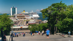 Timelapse of walking people at Potemkin Stairs with a view on the sea port and d Stock Footage