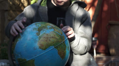 Child playing with the Globus Stock Footage