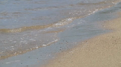 Waves gently roll in closeup Stock Footage