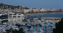 Ultra HD 4K Illuminated Aerial View Cannes Skyline, Iconic Yachts Sailboats Stock Footage