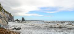 Panorama of an ocean shore Stock Photos