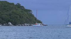 Sailboat island overcast zoomout Stock Footage
