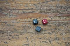 Vintage three dices with triple six on the wood floor Stock Photos