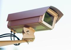 Enclosed professional security video camera mounted outside home protection Stock Photos
