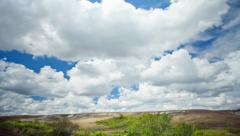 view over the meadows and hills in the summer sky with clouds - stock footage