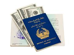 afghanistan passport and money isolated on white background - stock photo