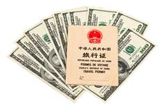 Chinese travel permit and us dollars over white Stock Photos