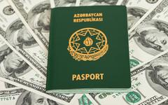azerbaijan passport on us dollars background - stock photo