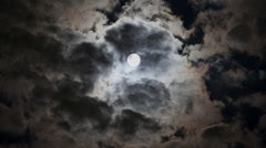 moon in a cloudy sky - stock footage