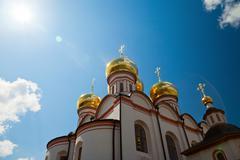 cupolas of russian orthodox church against blue sky - stock photo