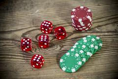 dice on the wooden table - triple six, one and five - stock photo