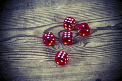 Dice on the wooden table - triple six, one and five Stock Photos