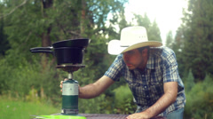 Propane cooking outdoor cowboy Stock Footage