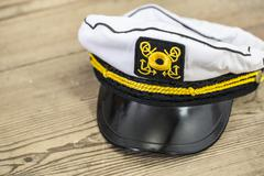 Sailor's cap on the wooden floor - for kids Kuvituskuvat