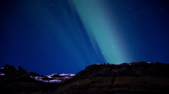 Northern lights (aurora) over the Rugged Icelandic mountains, 4k Stock Footage