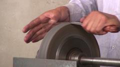 Sharpening knives at bazaar Stock Footage