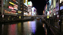 Neon lights reflected on river at night in Osaka Stock Footage