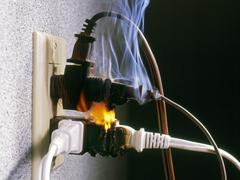 danger, wires on fire - stock photo