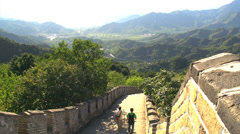 People walking down at the great wall Stock Footage