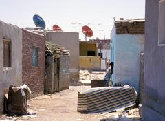 poor section of hurgada with tv satelite dishes, egypt - stock photo