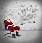 santa claus with telephone - stock photo