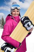 Stock Photo of female snowboarder