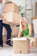 unpacking in new apartment - stock photo