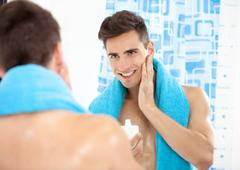 handsome man after shave - stock photo
