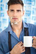 young man looking his injury face in mirror - stock photo