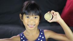 Proud Girl With 1932 Olympic Gold Medal-Close Up Stock Footage