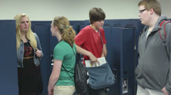 Students (kids) visiting lockers in school Stock Footage