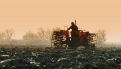 0076 Tractor at work in a farm land Stock Footage