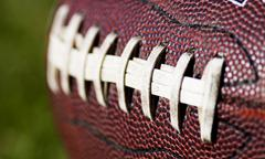 American football close up on field Stock Photos