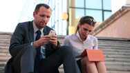 Businesspeople working with smartphone and tablet in city HD Stock Footage