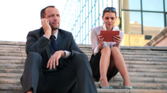 Business people with tablet computer and cellphone in the city HD Stock Footage