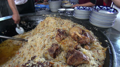 Plov, or pilaf, in Uzbekistan, Central Asia Stock Footage