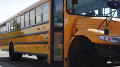 Kids getting off bus, walking to school - stock footage