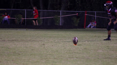 Onside kick of high school football game Stock Footage
