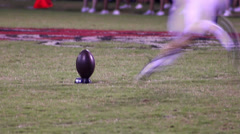 High School Football slow motion kick off Stock Footage