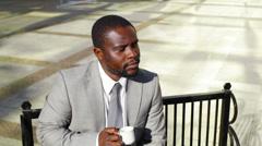 Pensive coffee drinker Stock Footage