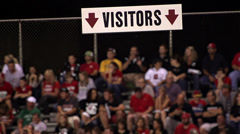 Visitors section of High School football game - faces blurred Stock Footage