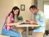Stock Video Footage of Young couple with bills and tablet computer in home NTSC