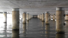 Concrete Bridge Pillars in Water 1 Stock Footage