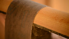 Luthier sanding the mast of a guitar Stock Footage