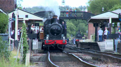 Steam Train at Railway Staion on the Bluebell Railway Stock Footage